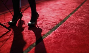 A television reporter is interviewed during preparations on the red carpet for the 85th Academy Awards in Hollywood